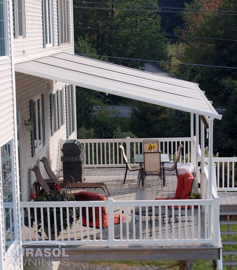 Pinnacle One awning with structure on deck patio